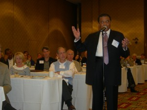 Clayton Chair Eldrin Bell makes a comment at session with Daniel Ortega