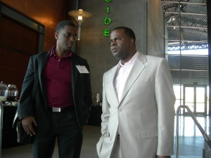Wole Ralph, vice chairman of the Clayton Commission, confers with Atlanta Mayor Kasim Reed during LINK trip