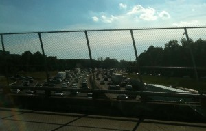Afternoon rush-hou traffic backs up on I-285 beneath the Ga. 400 overpass. Credit: David Pendered