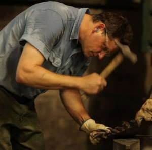Andrew Crawford hammering