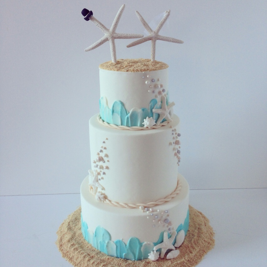 White with blue beach wedding cake