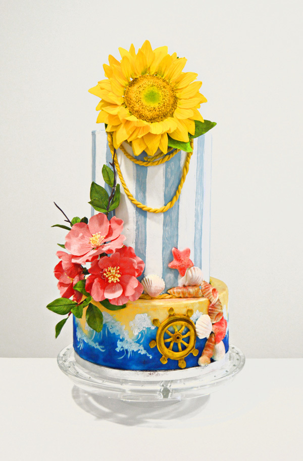 Blue and white striped nautical cake with sun flower