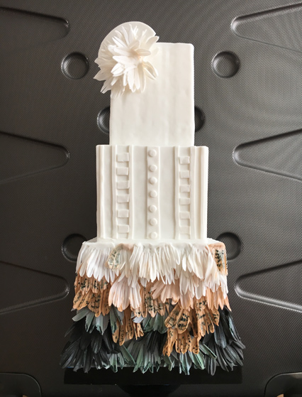 White with fringe couture wedding cake