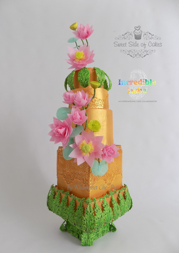 gold with green indian inspired cake with pink sugar flowers