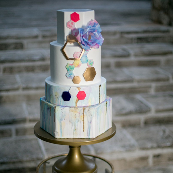 White fondant wedding cake with geometric pattern