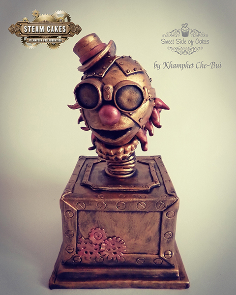 Gold plated steampunk cake
