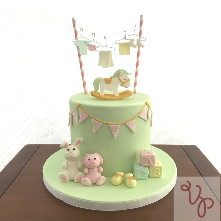 pastel green baby shower cake with animals