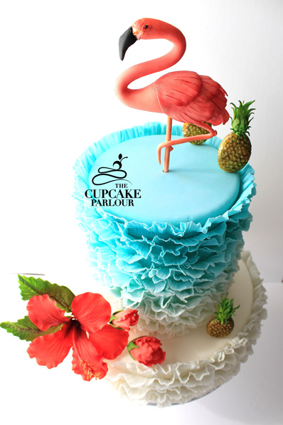 Ombre ruffle flamingo and pineapple themed cake