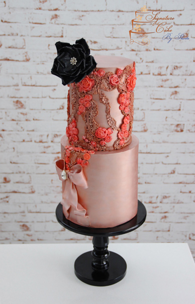 Blush wedding cake with gold and coral details