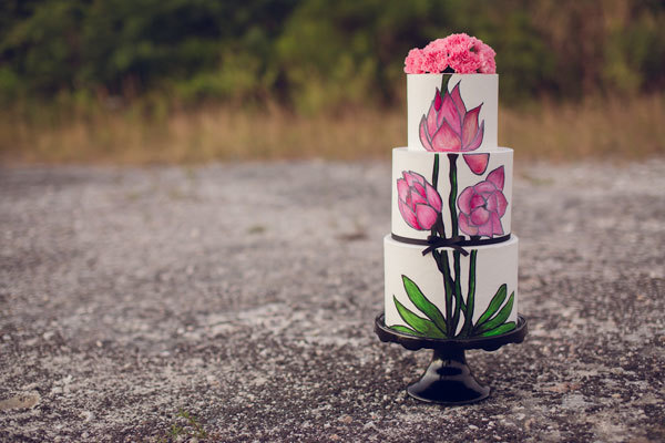 White fondant wedding cake with hand painted pink flower