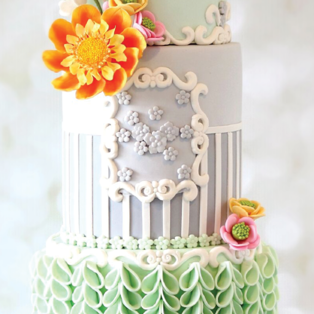 Gray and pastel green fondant cake with orange sugar flower