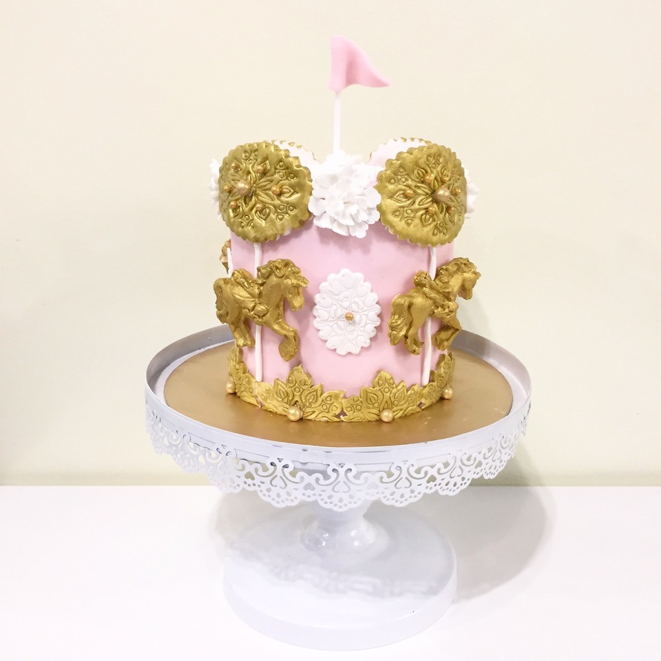 Mini pink baby cake with gold horse carousel