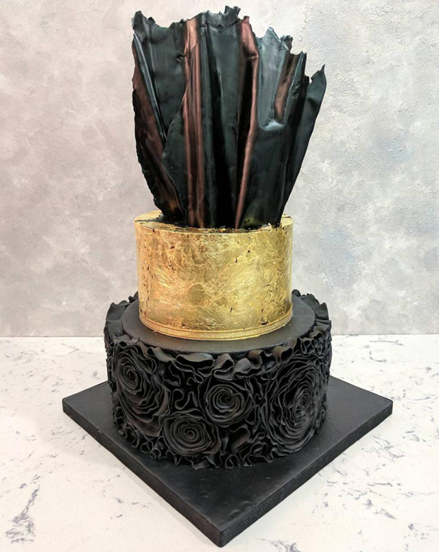 Black ruffle wedding cake with gold tier