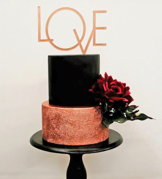 Black wedding cake with copper tier