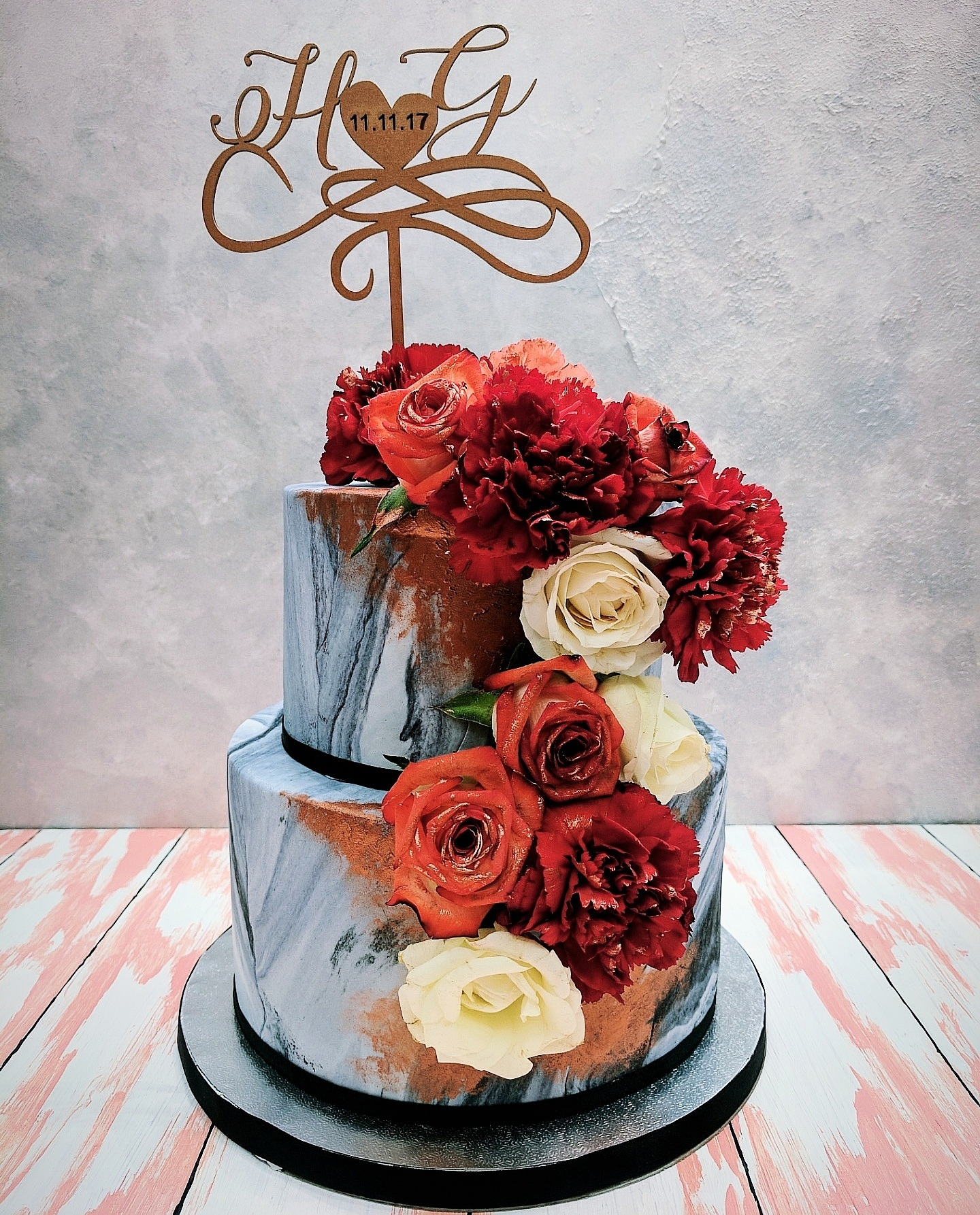 Gray Marbled wedding cake with burnt orange sugar flowers