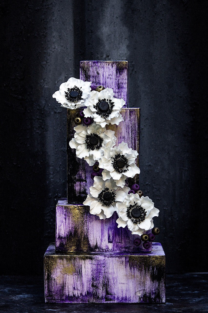 Purple wedding cake with gum paste sugar anemones