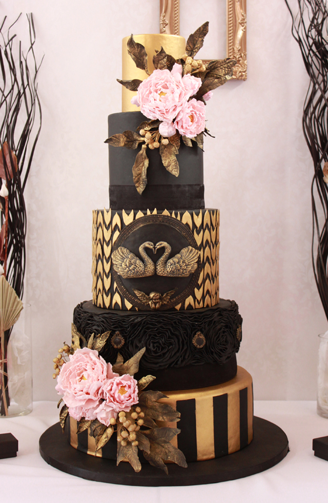 Black baroque wedding cake with gold