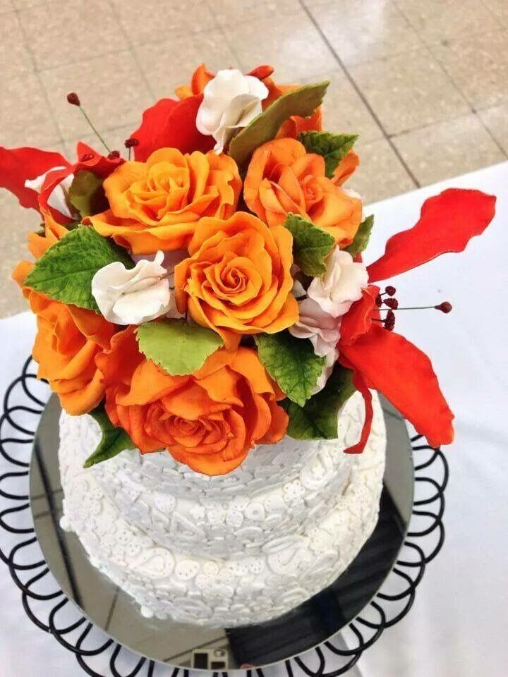 White Wedding cake with Orange Sugar Flowers