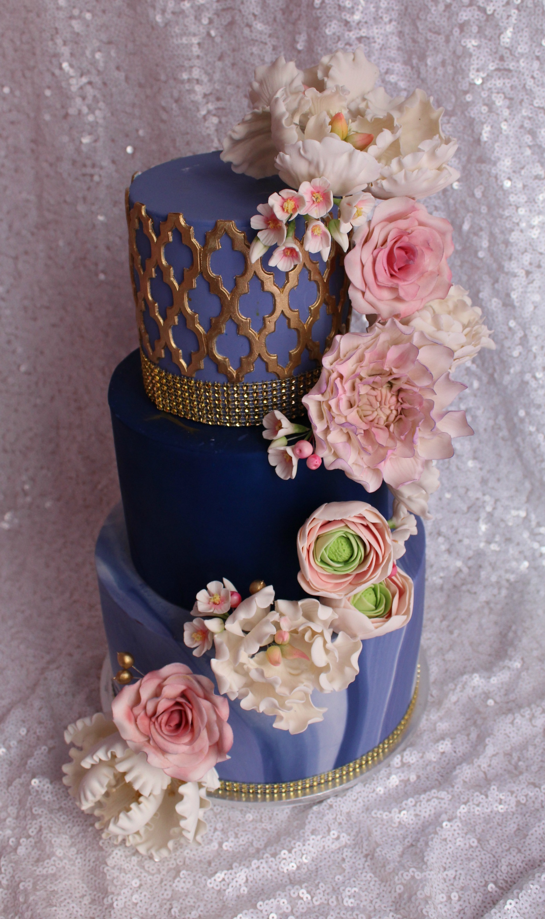 Navy blue wedding cake with cascading sugar flowers