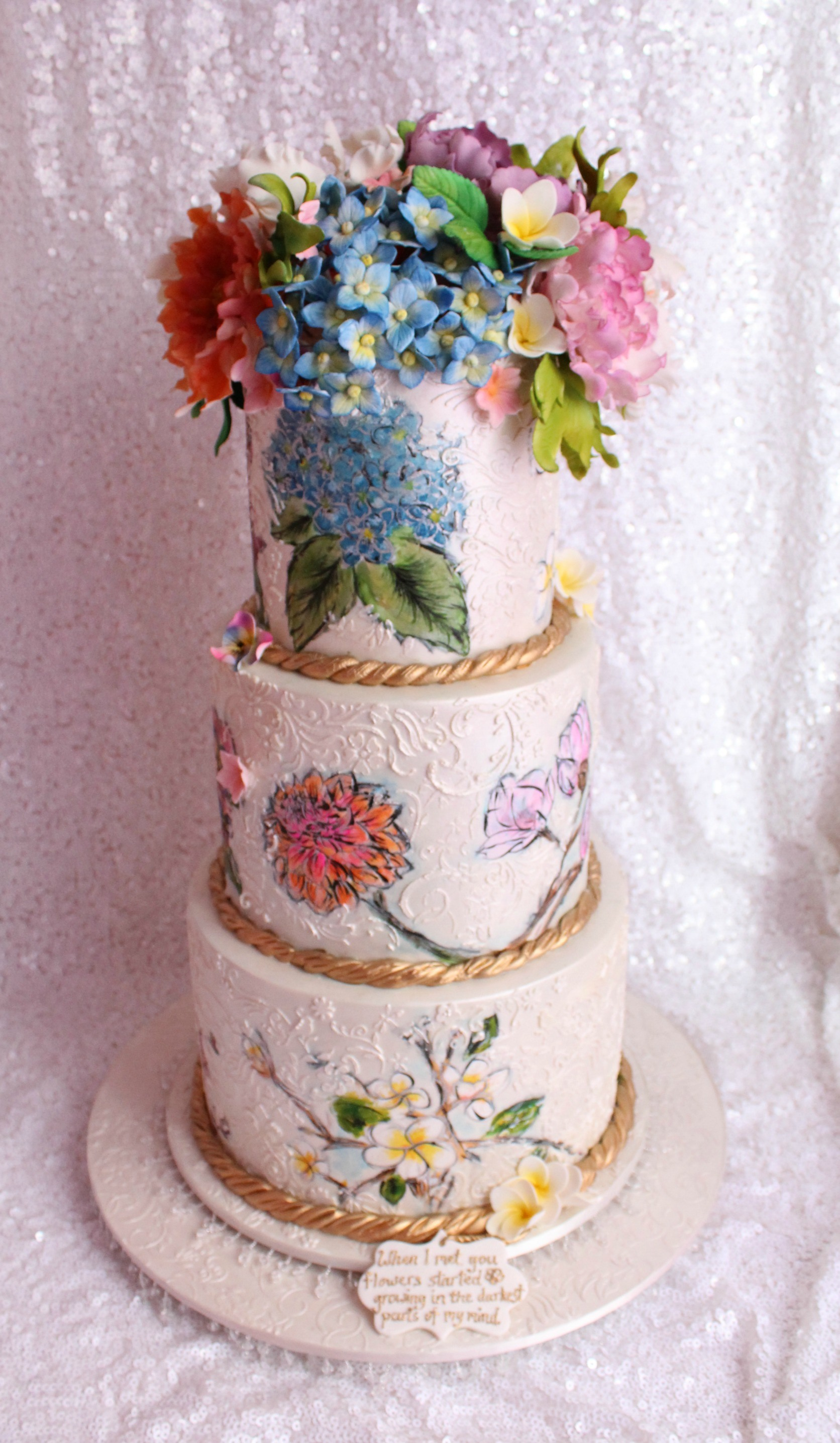 Ivory wedding cake with hand painted flowers
