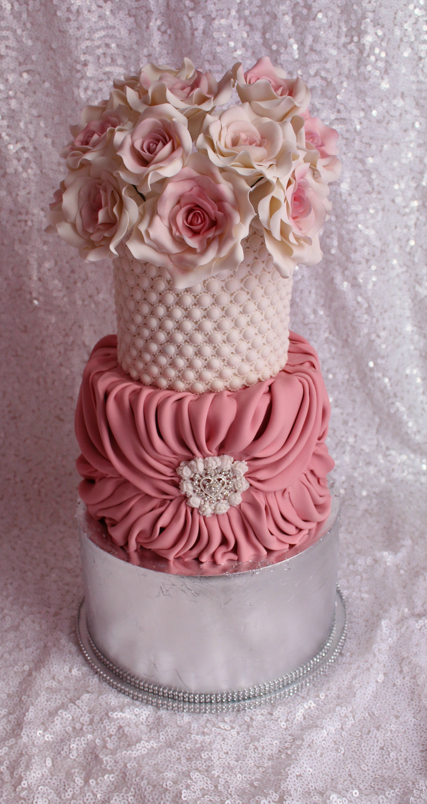 Pink Wedding cake with pink sugar roses