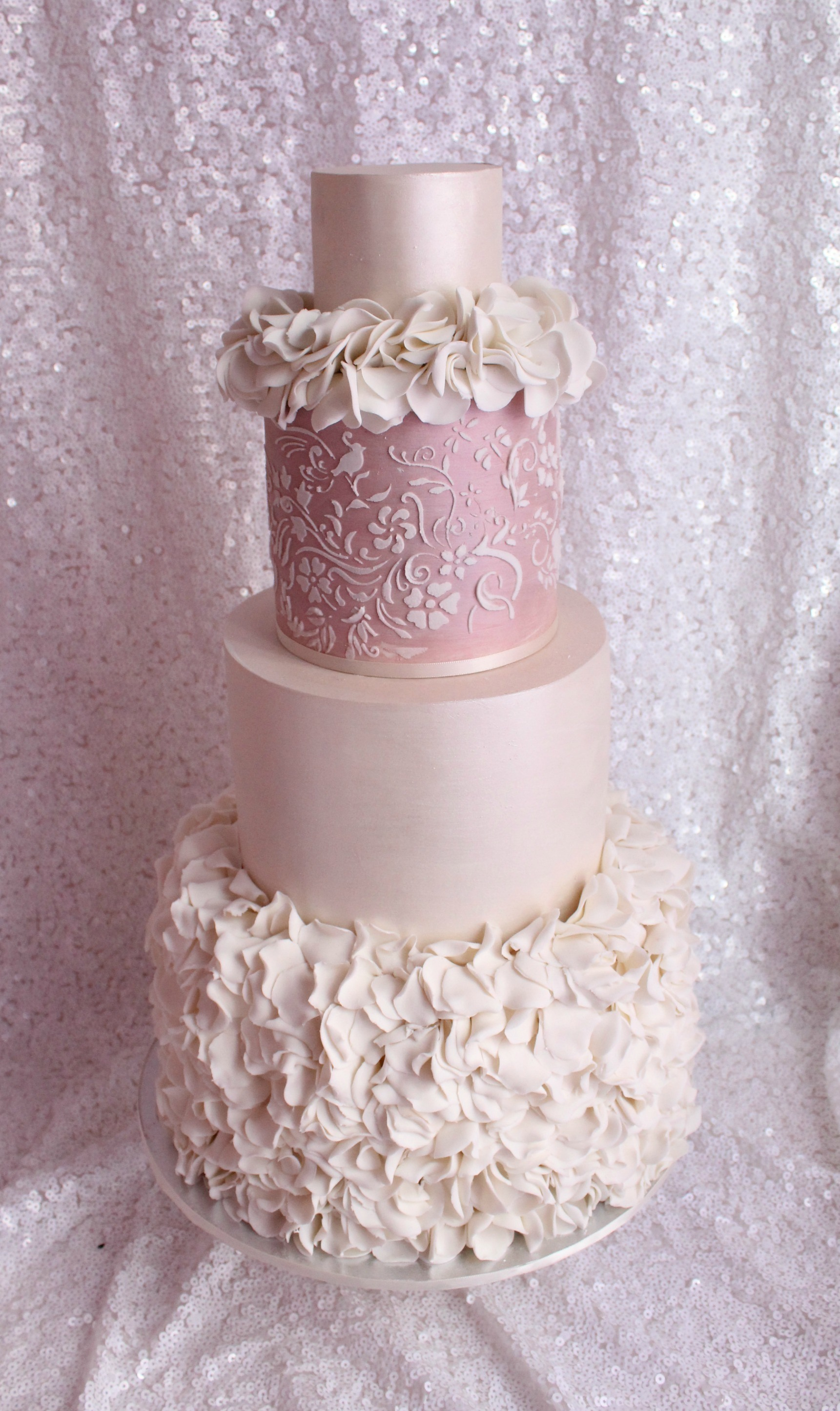 Pink and white ruffle wedding cake