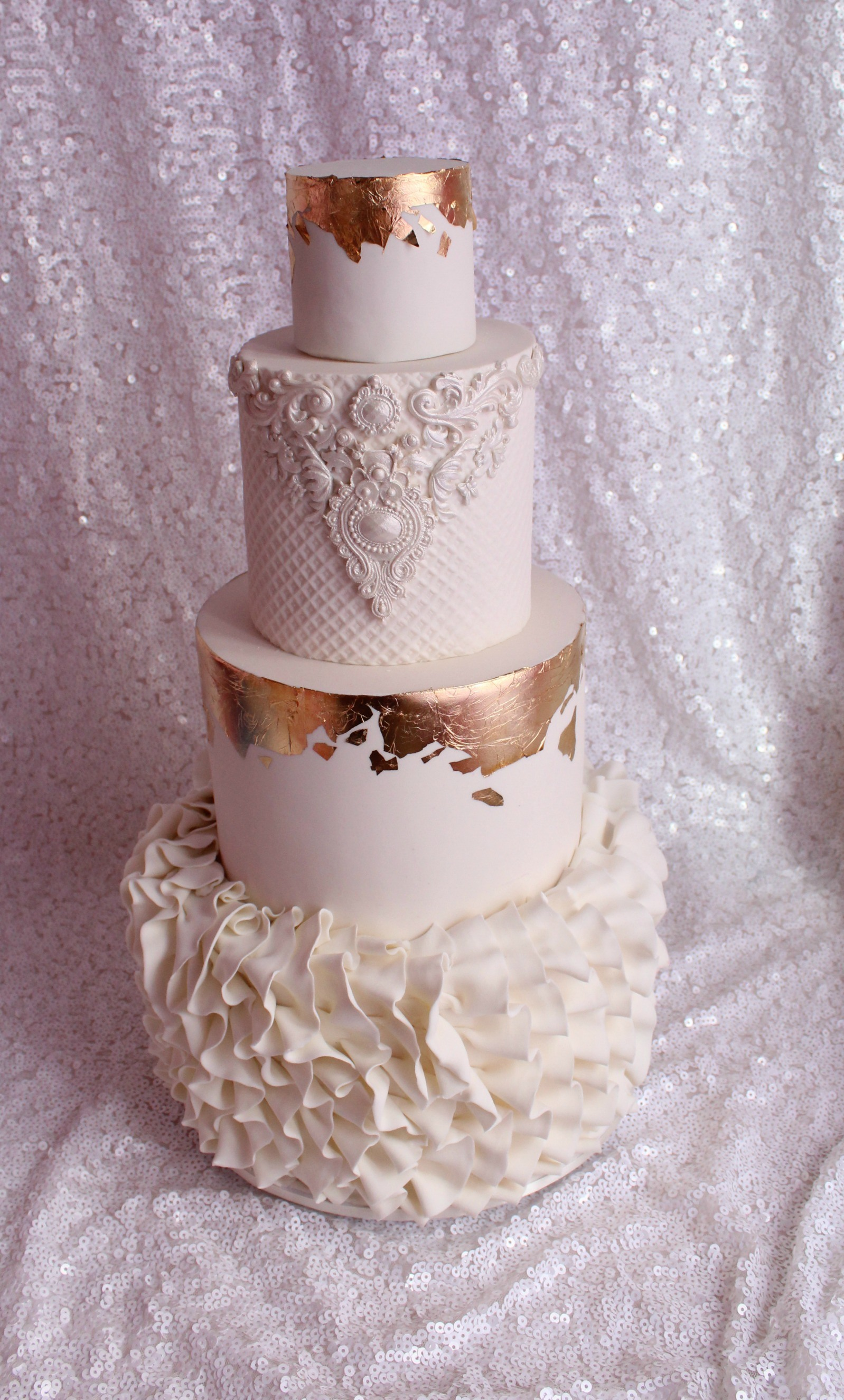 White wedding cake with ruffles