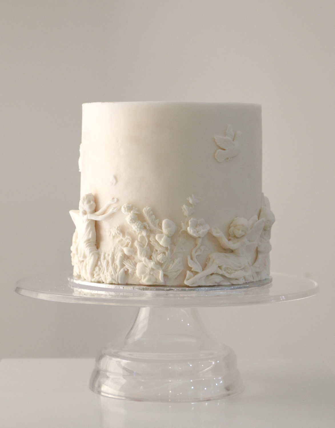 White mini cake with bas relief texture