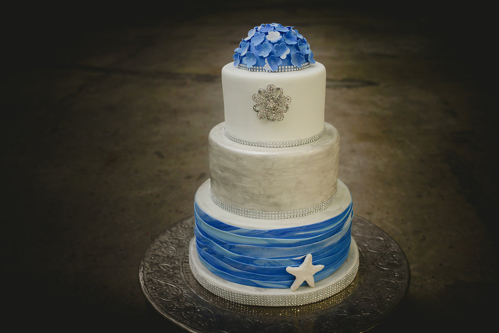 Blue and white fondant beach wedding cake