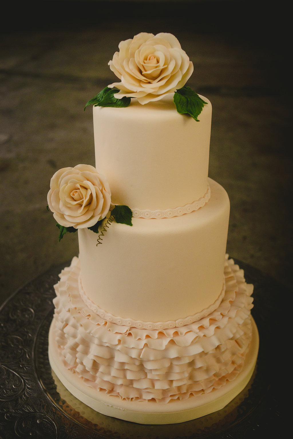 Ivory fondant wedding cake with ruffles