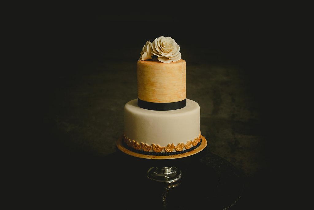 Gold and ivory fondant wedding cake