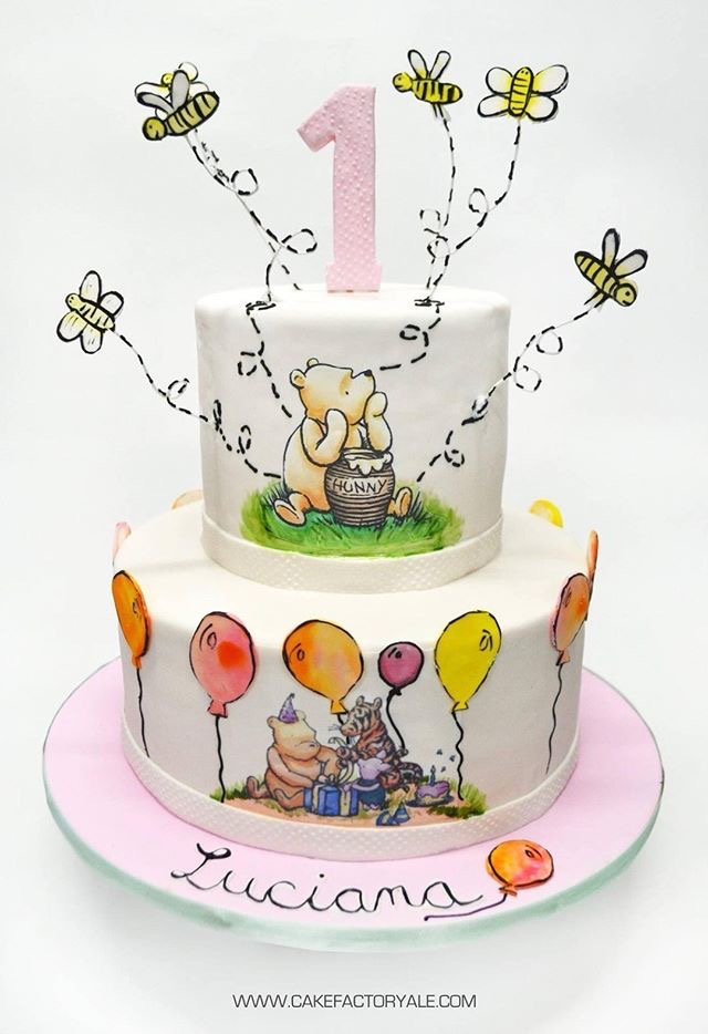 Handpainted winnie the pooh first birthday fondant cake