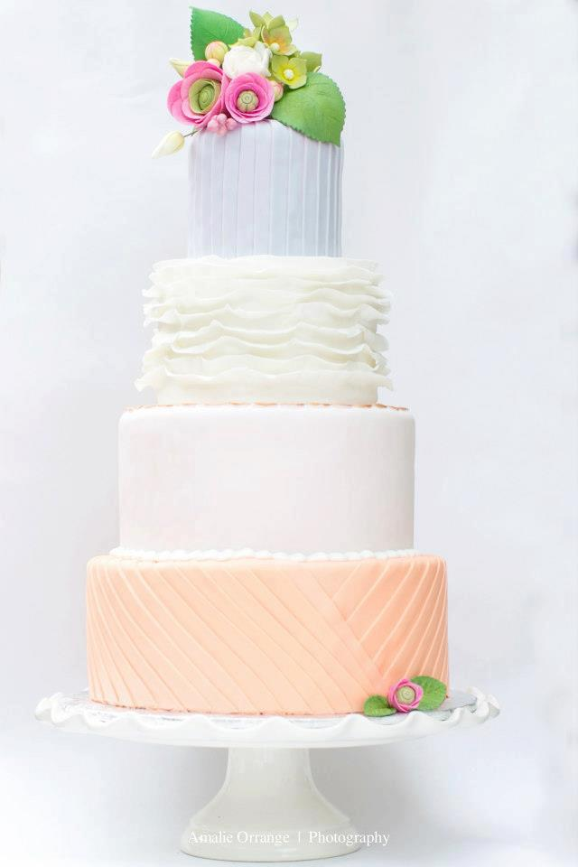 Peach white and lavender fondant wedding cake