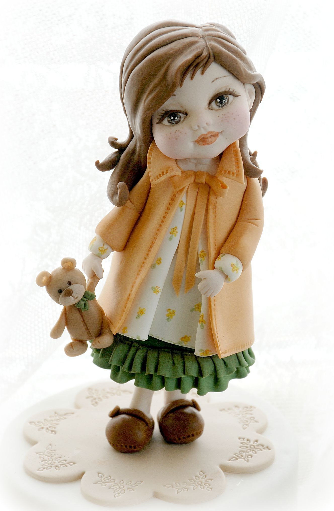 Little girl with teddy bear fondant figurine