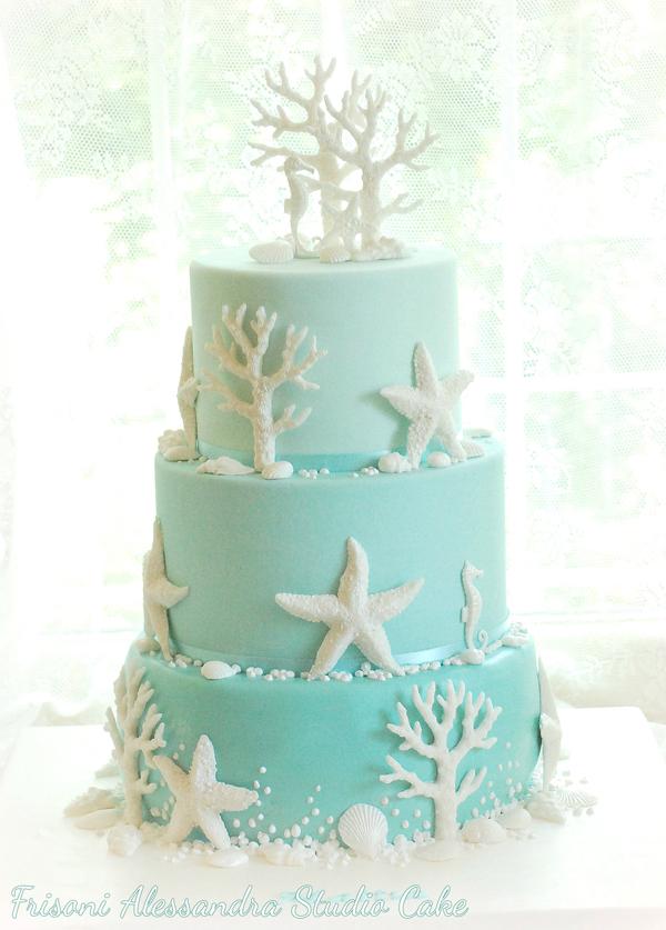 Light blue fondant wedding cake with white seashells
