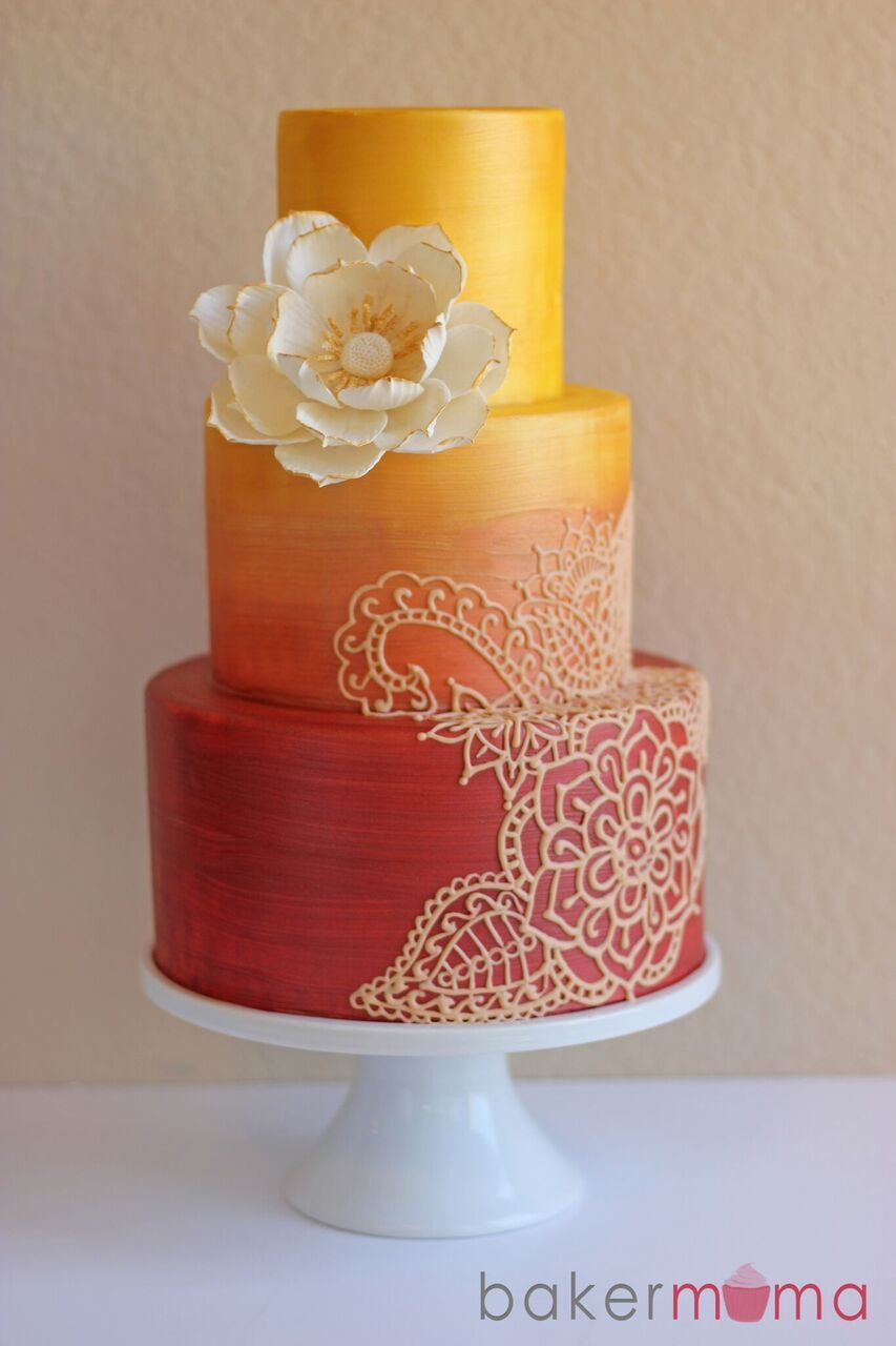 Orange and yellow fondant ombre wedding cake