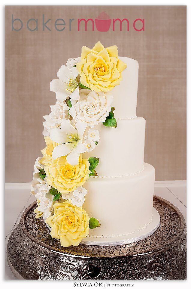 White wedding cake with yellow sugar flowers