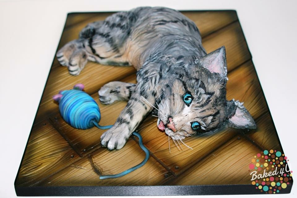 Airbrushed shaped gray kitten cake