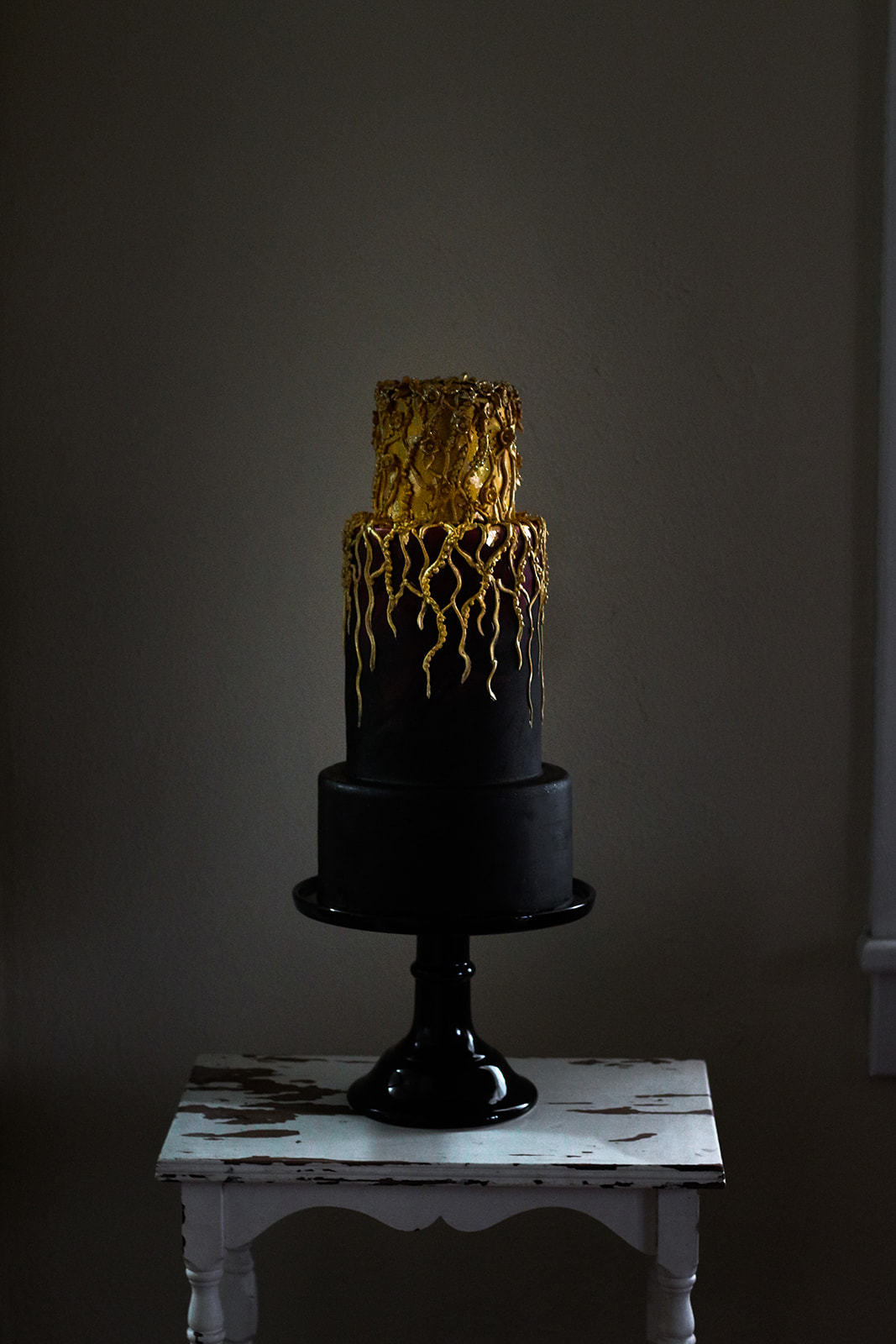 All black wedding cake with gold streaks