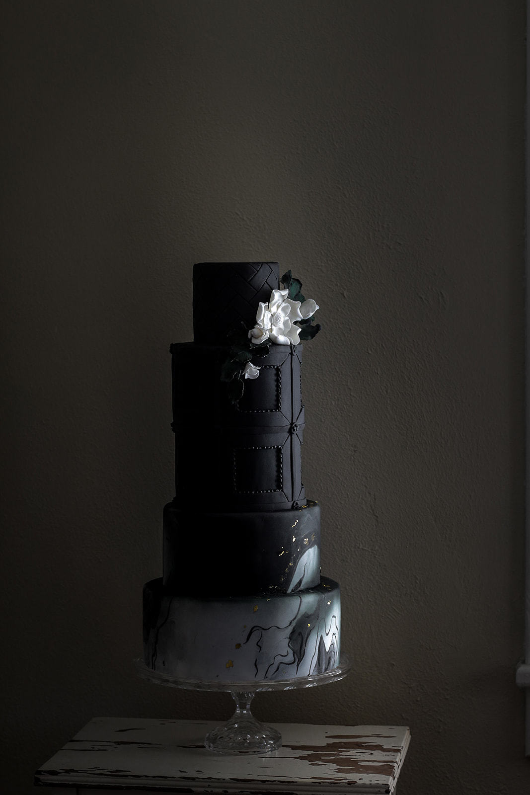 All black wedding cake with gray marbling