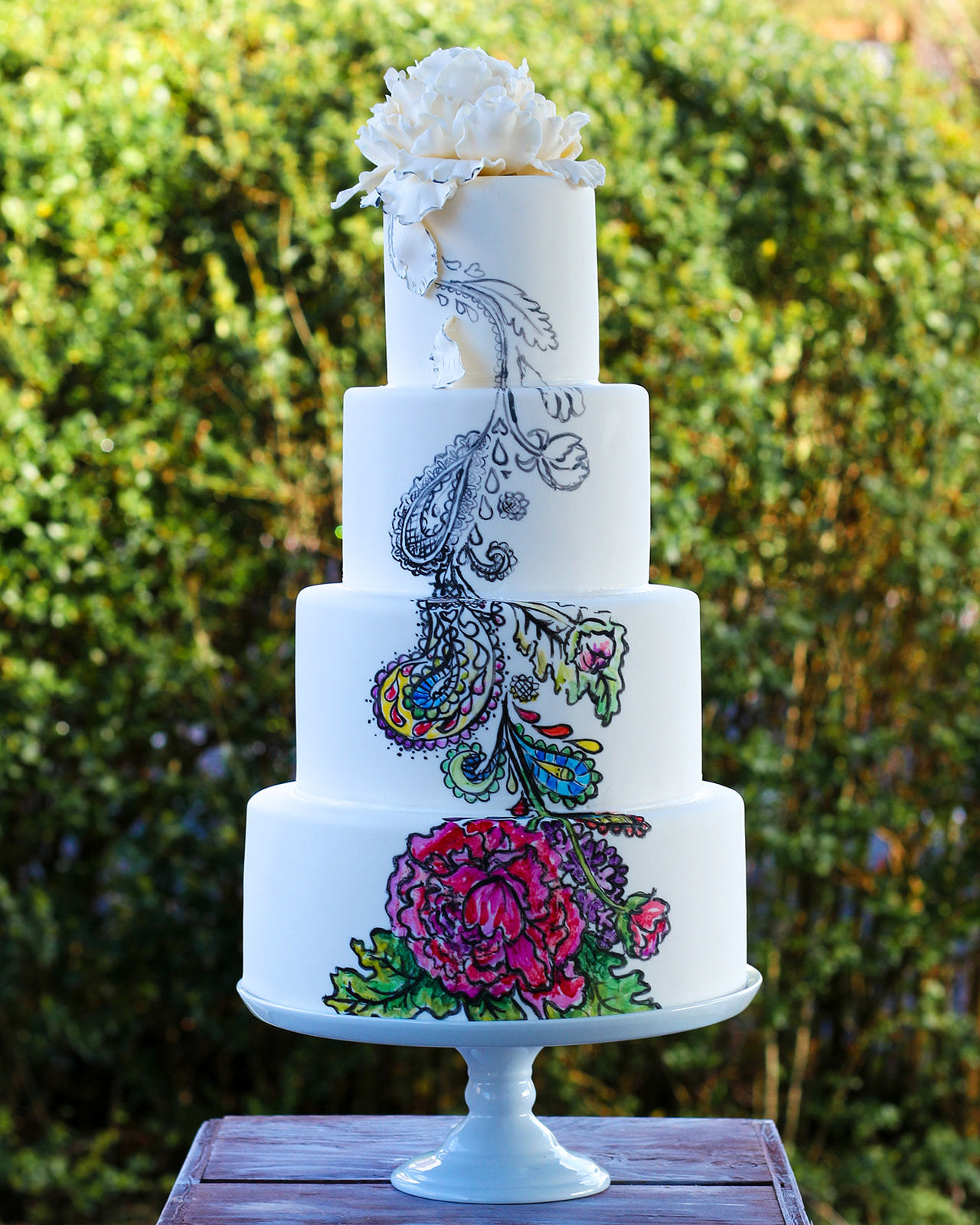 White wedding cake with handpainted flowers