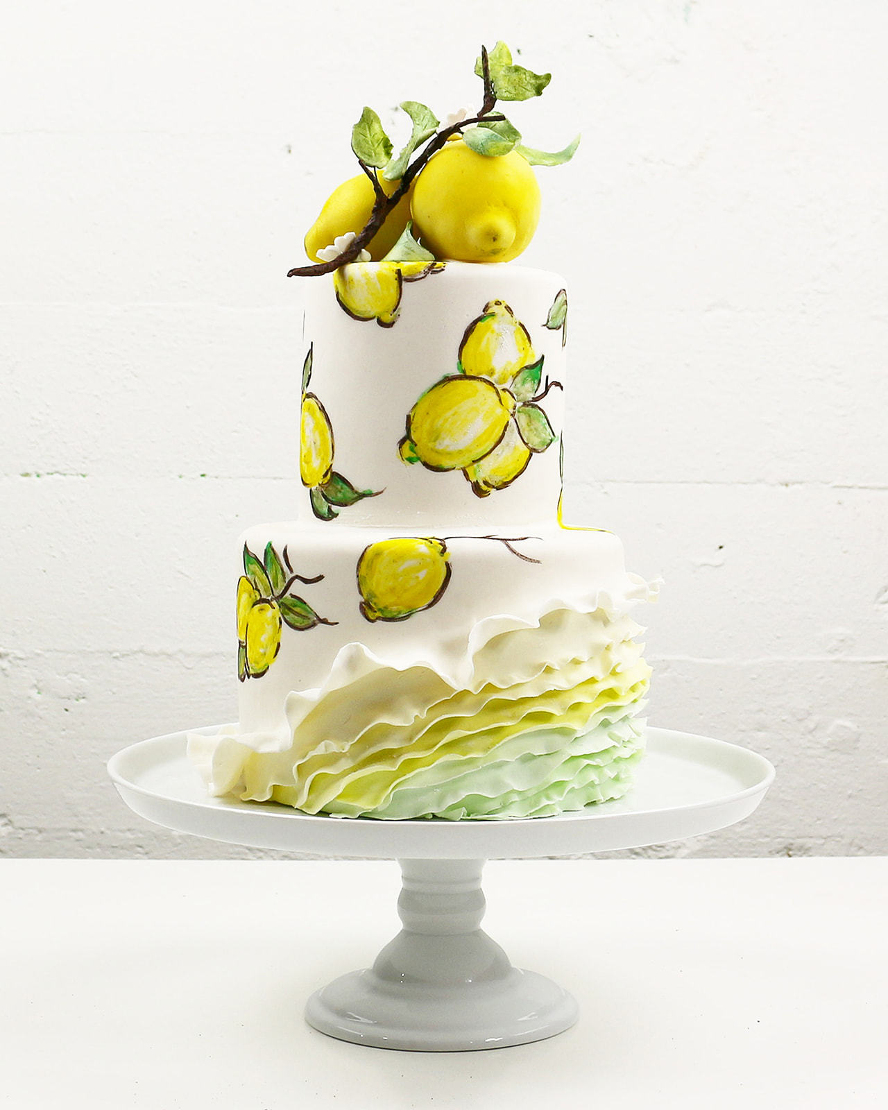 Yellow and white ruffle Lemon inspired wedding cake