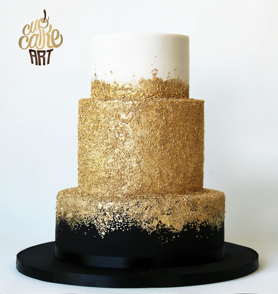 Gold sparkle and black fondant wedding cake