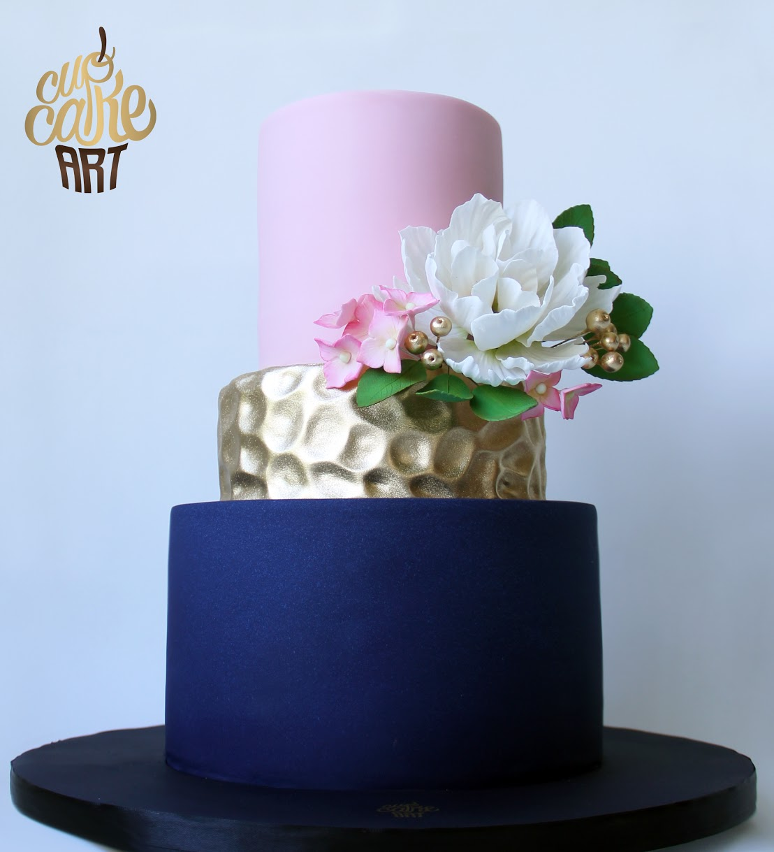 Navy blue and pink fondant wedding cake with gold