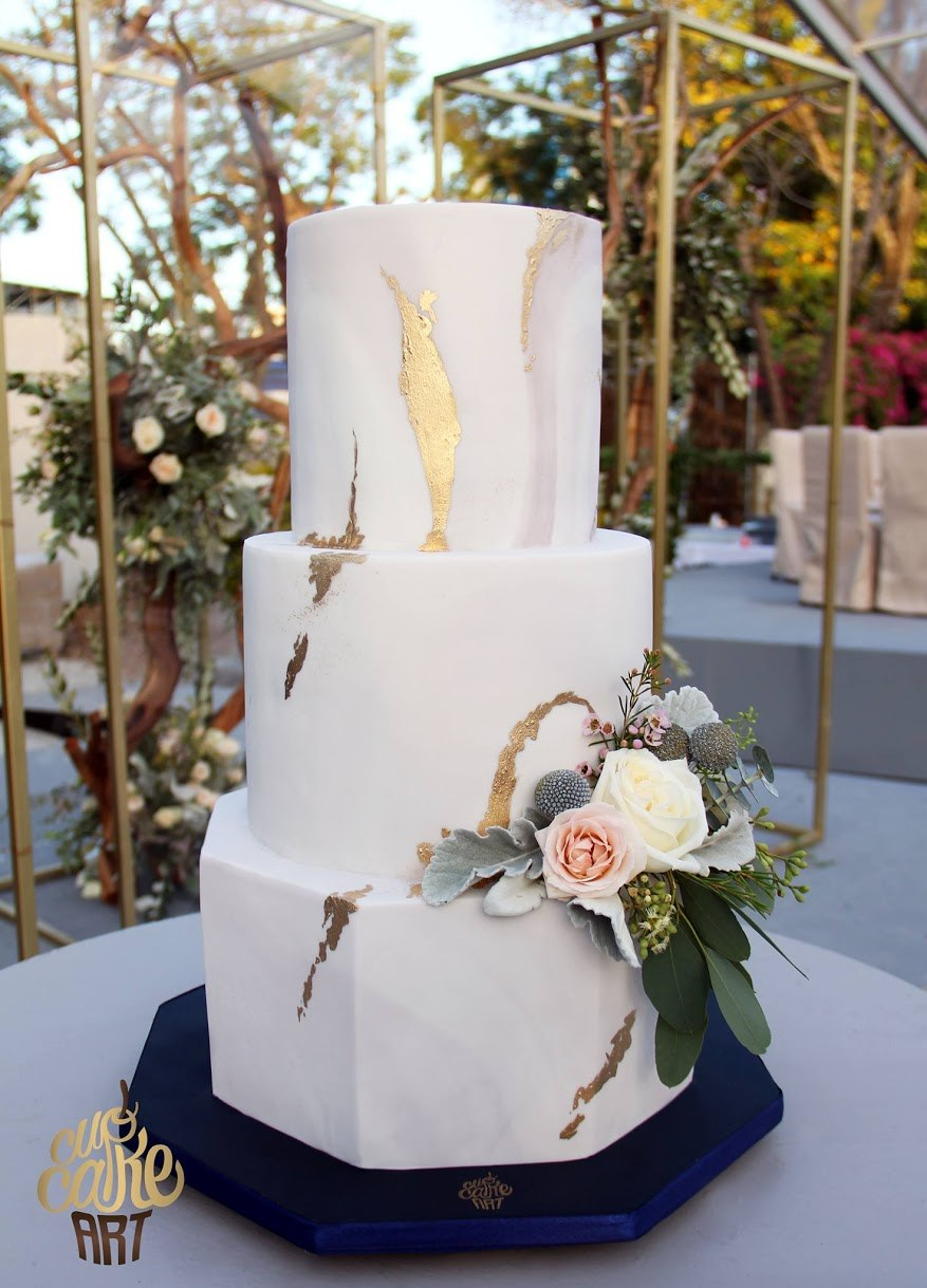 All ivory wedding cake with gold leaf streaks