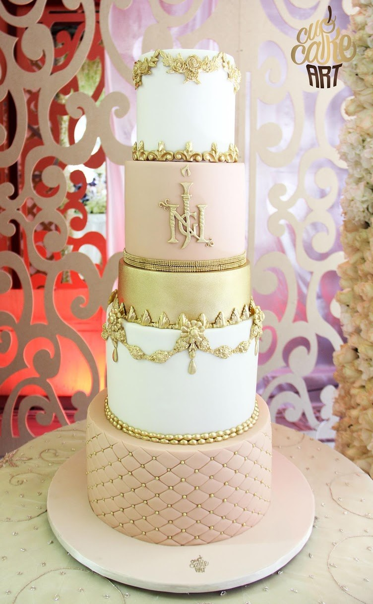 Peach and white with gold leaf wedding cake
