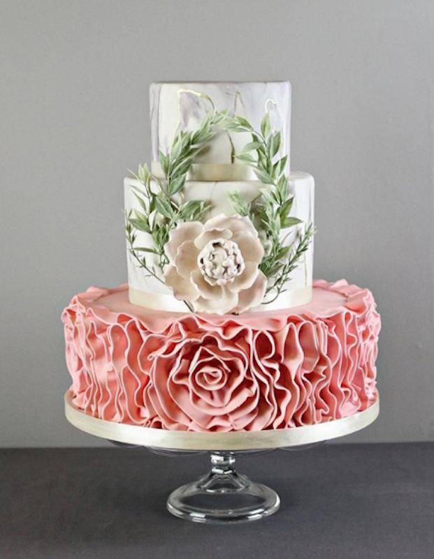 White and peach ruffled fondant wedding cake