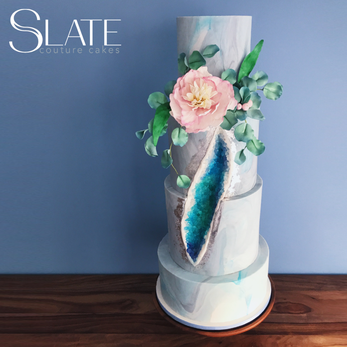 Light blue fondant wedding cake with turquoise crystals