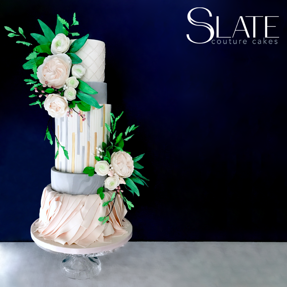 Gray and white wedding cake with sugar flowers;
