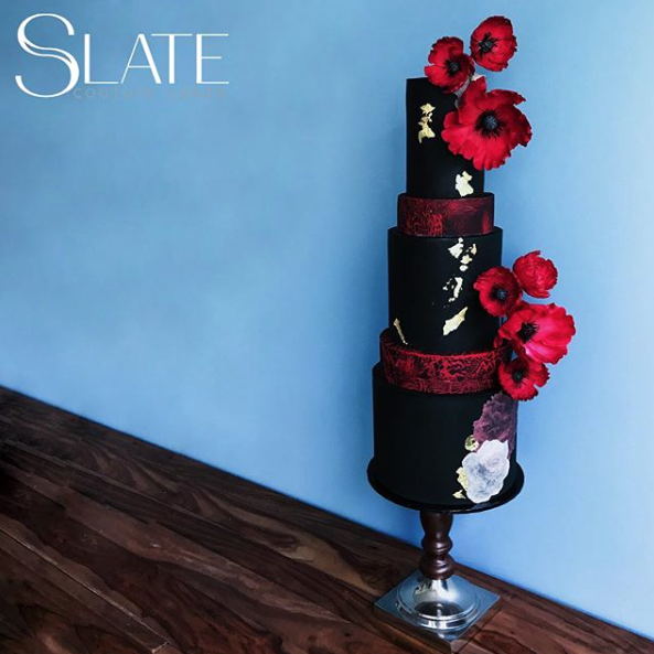 Black wedding cake with gothic red sugar flowers